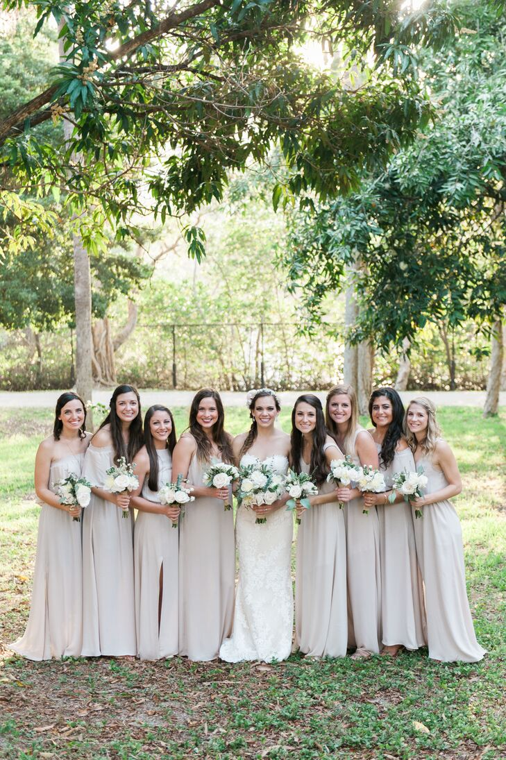 Ashleigh dressed her bridesmaids in various champagne-colored, floor-length dresses from Show Me Your Mumu and long agate necklaces to fit her natural, earthy color scheme.