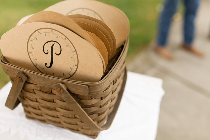 """To combat the Alabama heat, Alix and George made sure to provide guests with a few warm weather essentials to keep them comfortable during the ceremony. Guests could quench their thirst as the couple said their """"I do's"""" with icy cold bottles of water and cool themselves off with one of the handmade monogrammed fans."""