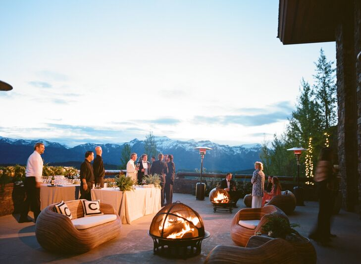 Neutral-colored elegant lounge furniture was placed around cozy fire pits on the porch of the venue overlooking the Teton Mountains and valley. A mariachi band played in the background as guests enjoyed a cocktail hour before the reception.