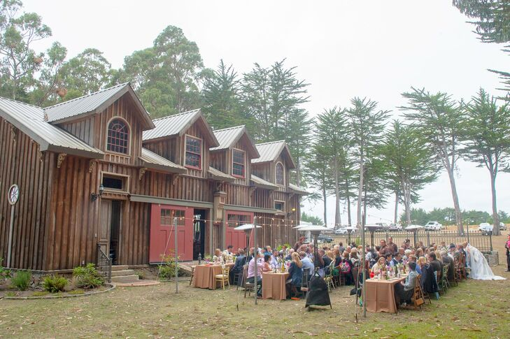 Guests enjoyed dinner on long, family-style tables that were placed outside the redwood barn.