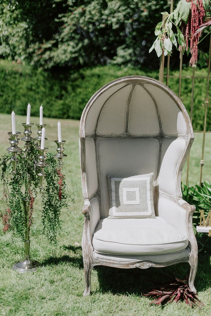 Lounge Chair with Candles and Greenery