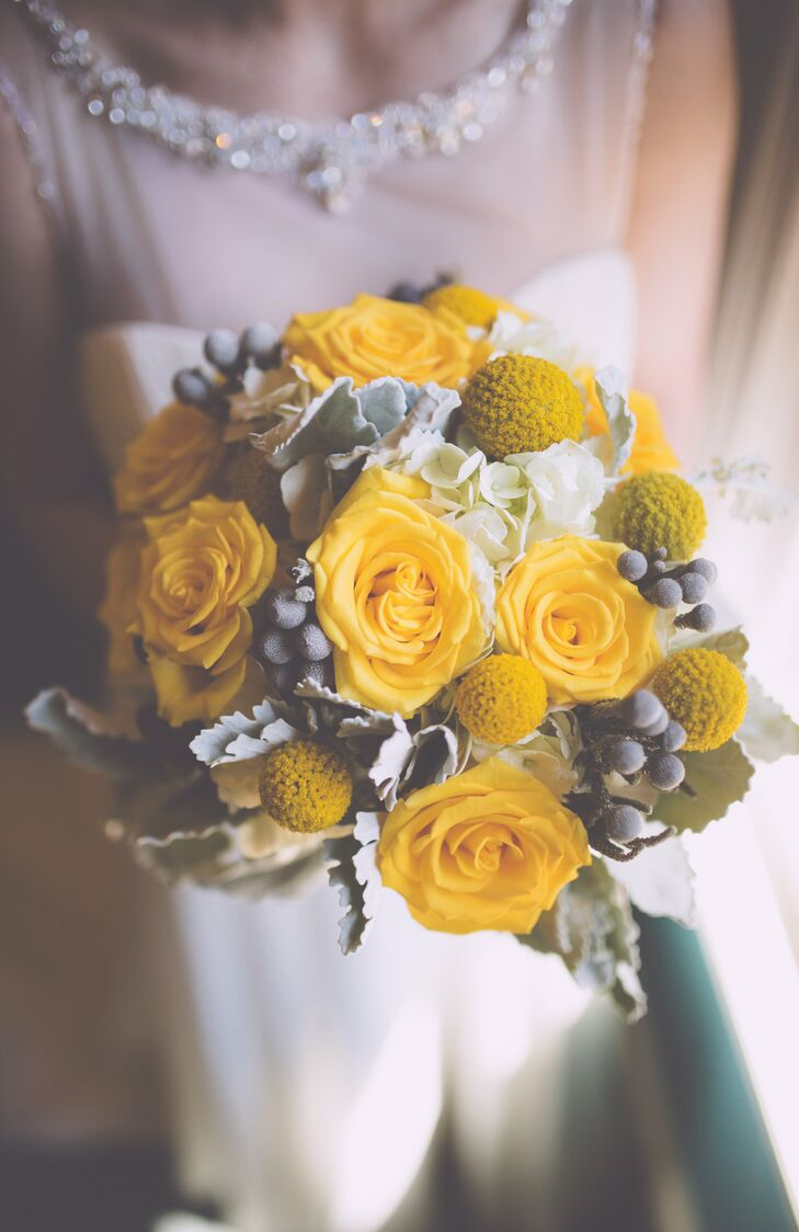 The couple like the idea of a yellow and gray color palette because it's cheery and simple. Alexa saw photos of billy balls, the small round flowers seen in her bouquet, on Pinterest and knew she wanted to have them incorporated into her flower arrangements and color palette.