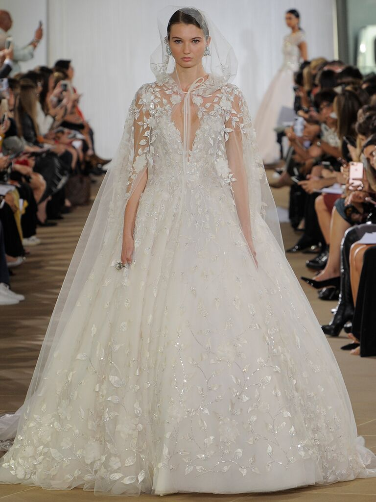 Ines Di Santo Fall 2019 floral-embroidered ball gown wedding dress with a floral-appliquéd hooded cape veil