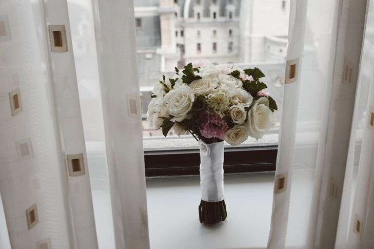 The bridal bouquet consisted of white roses, gardenias and hydrangeas.