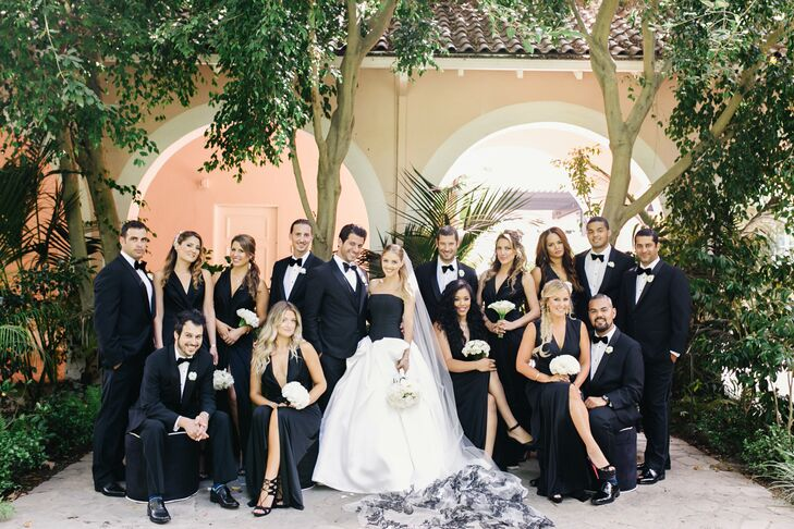 Black bridesmaid dresses perfectly matched the black-tie look of the groomsmen, and gave the whole wedding party a modern, chic look.