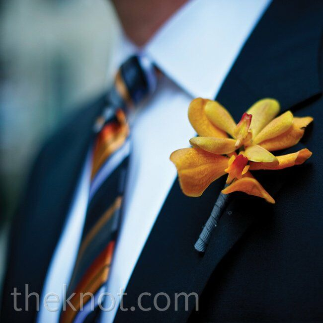 The groomsmen's striped ties included all the wedding colors, so their orange orchid boutonnieres coordinated perfectly.