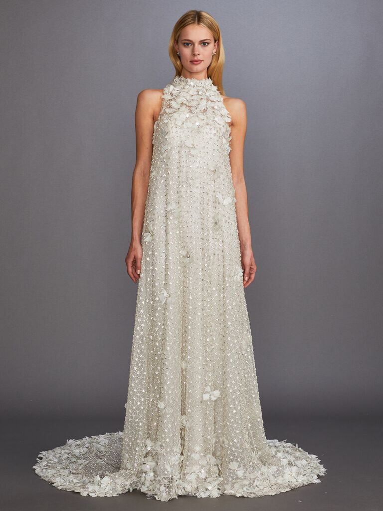 Allison Webb Fall 2019 Bridal Collection wedding dress with allover floral appliqués and a high neckline