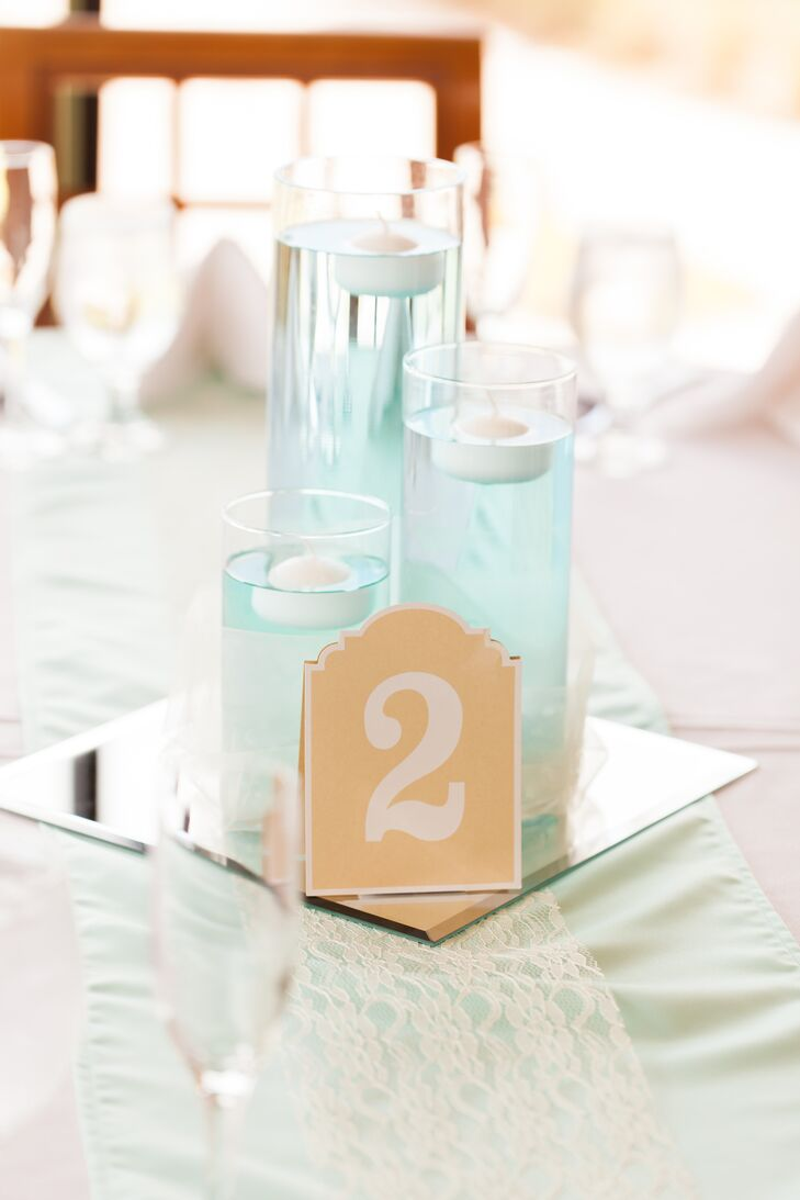 Cami and Tarik even added a sentimental touch into their reception at Eagle Creek Golf Club in Orlando, Florida. Each table was lined with a Tiffany blue satin and lace runner made by Cami's grandmother. A trio of matching blue floating candles on a mirror accent served as the centerpiece.