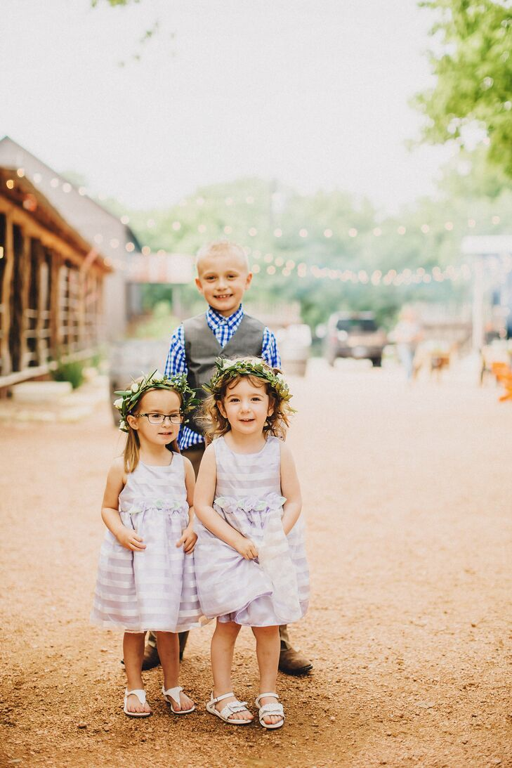 Their flower girls couldn't have looked sweeter! They wore striped lavender and ivory dresses from Target to match the bridesmaids. Each one had little fabric rosettes along the waist. To fit their natural setting, Rachel and Jason also gave his nieces flower crowns adorned with eucalyptus and white roses. If that wasn't cute enough, the 3-year-olds also carried little stuffed sheep down the aisle.