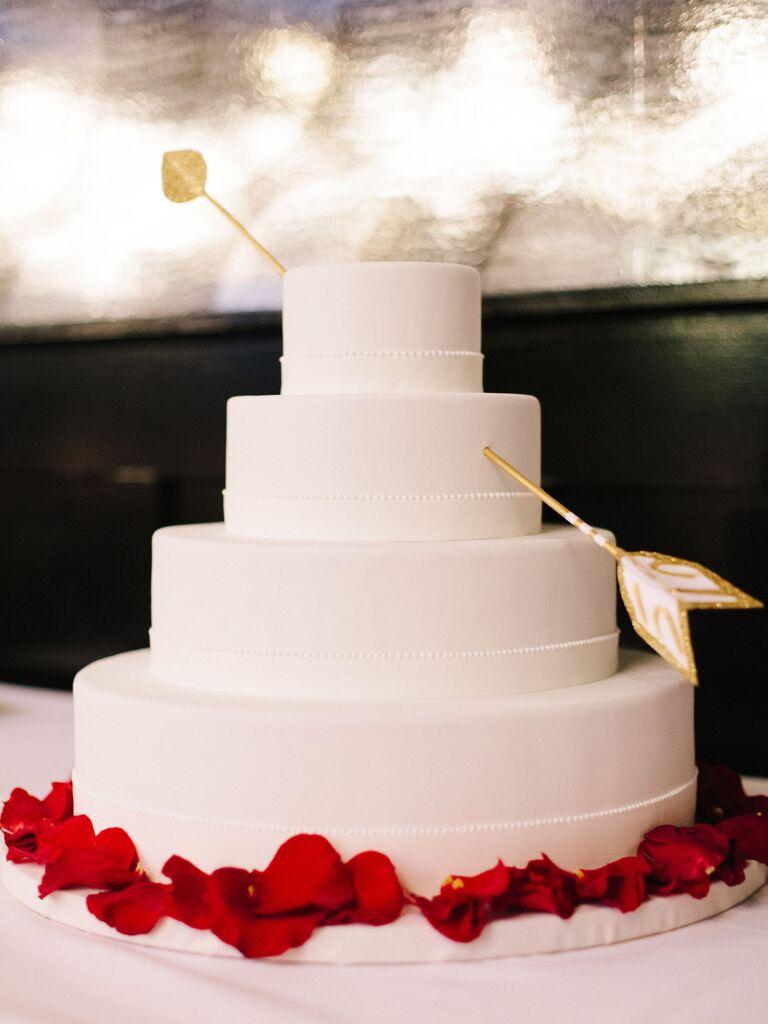 Cupid's arrow wedding cake décor
