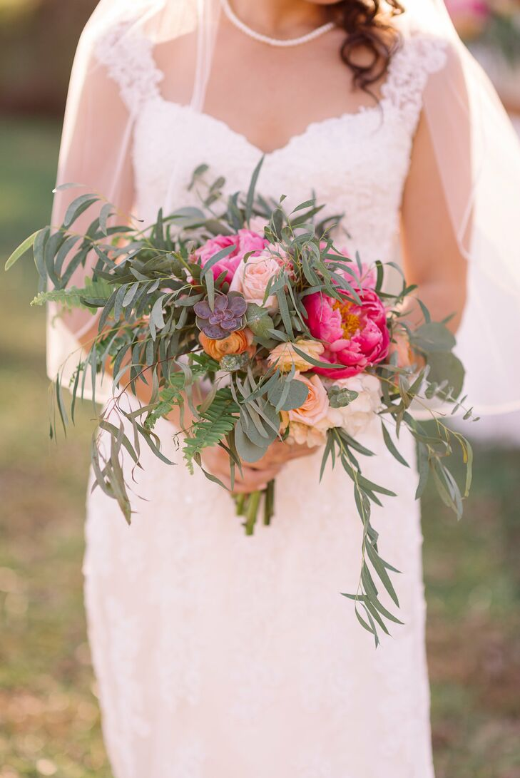 """""""We wanted big rustic blooms and unruly greens rather than stuffy organized bouquets,"""" Emma says of their bouquets, which incorporated peonies and roses."""