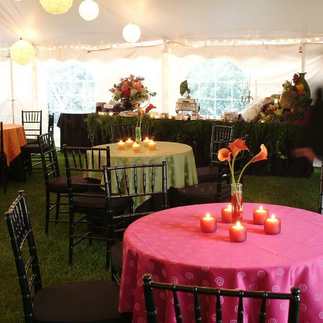 Doug found fabric by Robert Allen in several rich colors -- raspberry, blueberry, lime, lemon, and saffron -- and had them made into tablecloths for the reception tables. The couple also had Japanese lanterns strung around the tent to add ambient light.