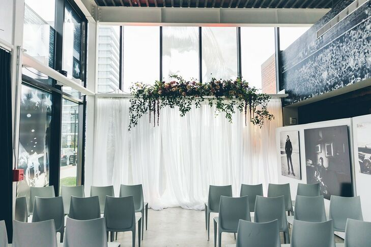 Modern Ceremony with White Draping and Gray Chairs at Danny Clinch Gallery in Asbury Park, New Jersey