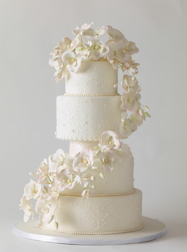 Dramatic white wedding cake with sugar orchid decorations