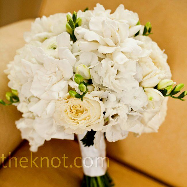 Lauren's fragrant white bouquet was made up of gardenias, roses, dahlias, freesia, sweet peas, ranunculus and hydrangeas.