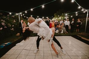 Energetic First Dance with String Lights and Dance Floor