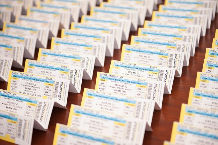 Instead of traditional escort cards, Jo and Robert designed their escort cards to resemble ticket stubs.