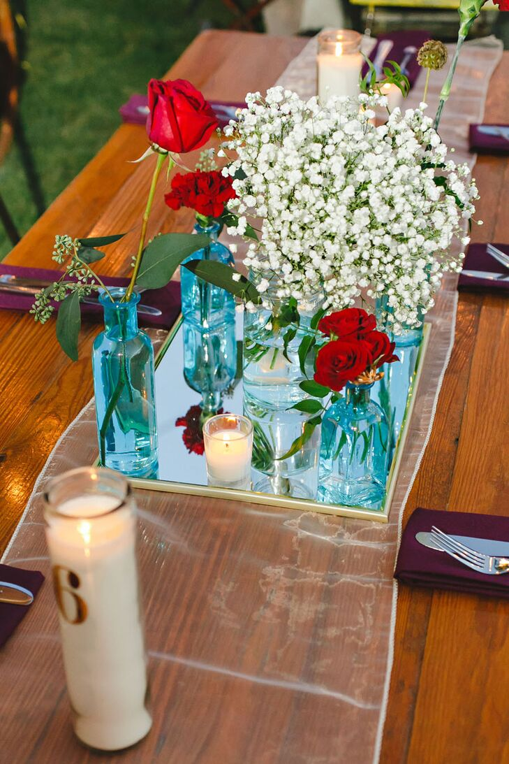 "Anika's advice: Be efficient and get creative. ""We used things that could do double duty. Table numbers were printed on tall candles,"" she says."