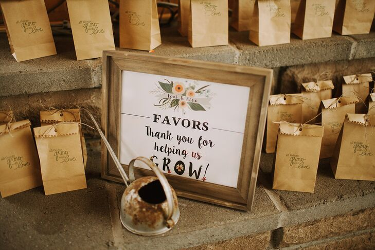 """Lexi and Alex gave away little brown bags stamped with """"All things grow with love"""" as wedding favors, which contained wildflower seed bombs for guests to take home and plant."""