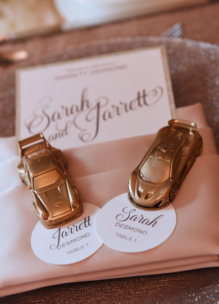"""Perhaps the most fun element of our wedding decor was our escort cards. Each guest found their name and table assignment card affixed to a Hot Wheels sports car painted in gold,"" Sarah says. ""Jarrett collects Hot Wheels and loves cars, so we thought this would be a fun way to share that with our guests. He even hand-picked certain cars for certain people."""