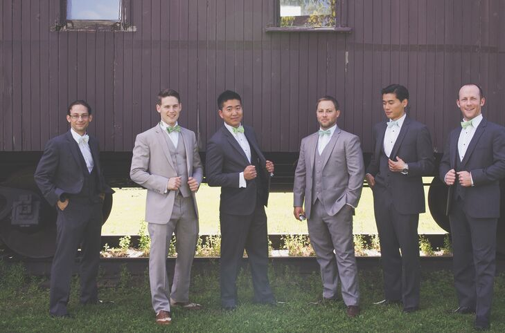 Brendan and his boys looked handsome in three-piece suits in various shades of gray. Brendan and his best man wore custom made pale gray suits, which they paired with fun green bowties. His groomsmen sported dark gray tuxedoes and bowties in a spectrum of green.