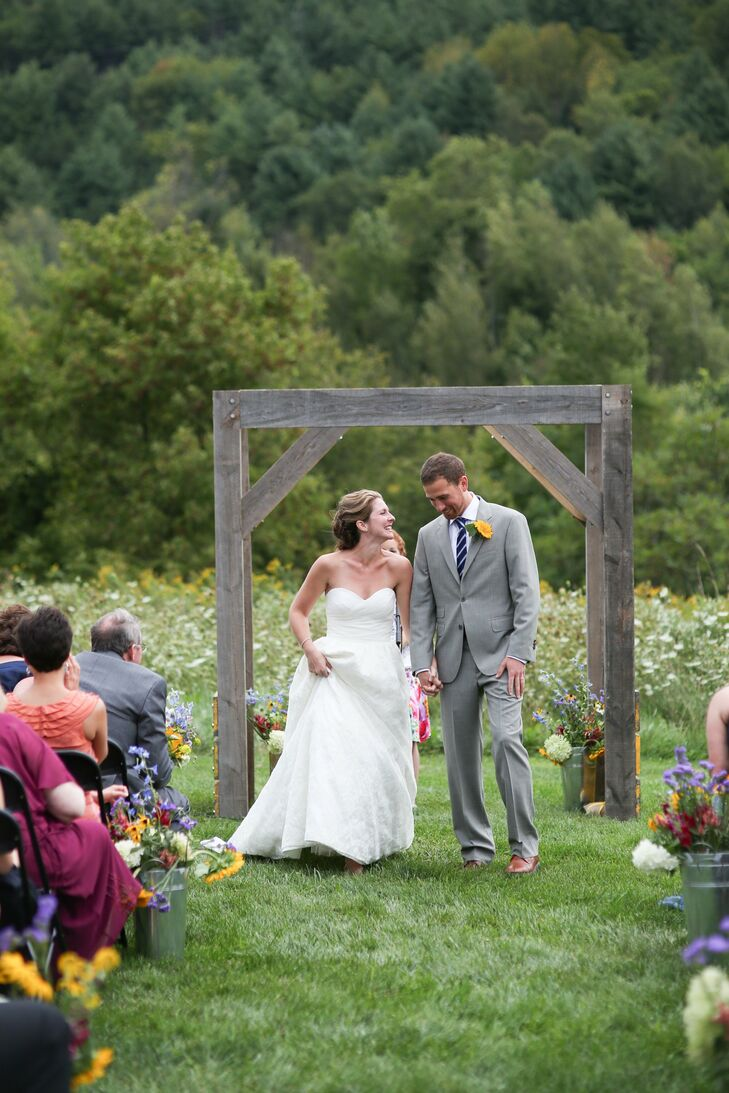 The ceremony was held in the meadow next to the West Monitor Barn. A simple wooden arch, tall grasses and a field of wildflowers came together for the perfect rustic backdrop.