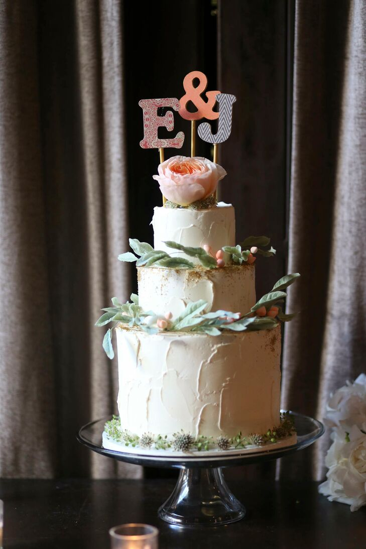 Lael Cakes whipped up a three-tiered, gluten-free and vegan wedding cake for Emma and Jesse's reception. The confection reflected the decor's rustic done through textured buttercream frosting and delicate greenery adorning each layer. For a note of playfulness, they topped the cake with an E and J cake topper, each letter displaying a fun, graphic print.