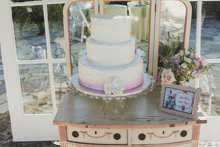 The three tiered white cake had a subtle purple ombre color on the bottom layer.