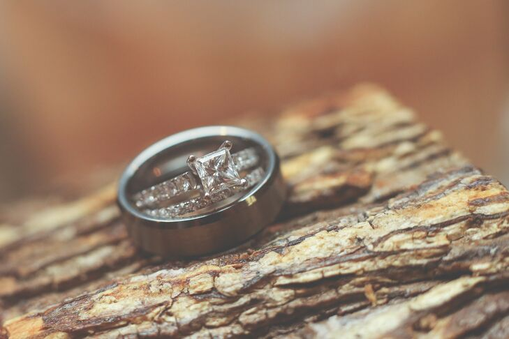 Josh proposed with a princess-cut diamond engagement ring. They paired it with a timeless diamond band at the ceremony.