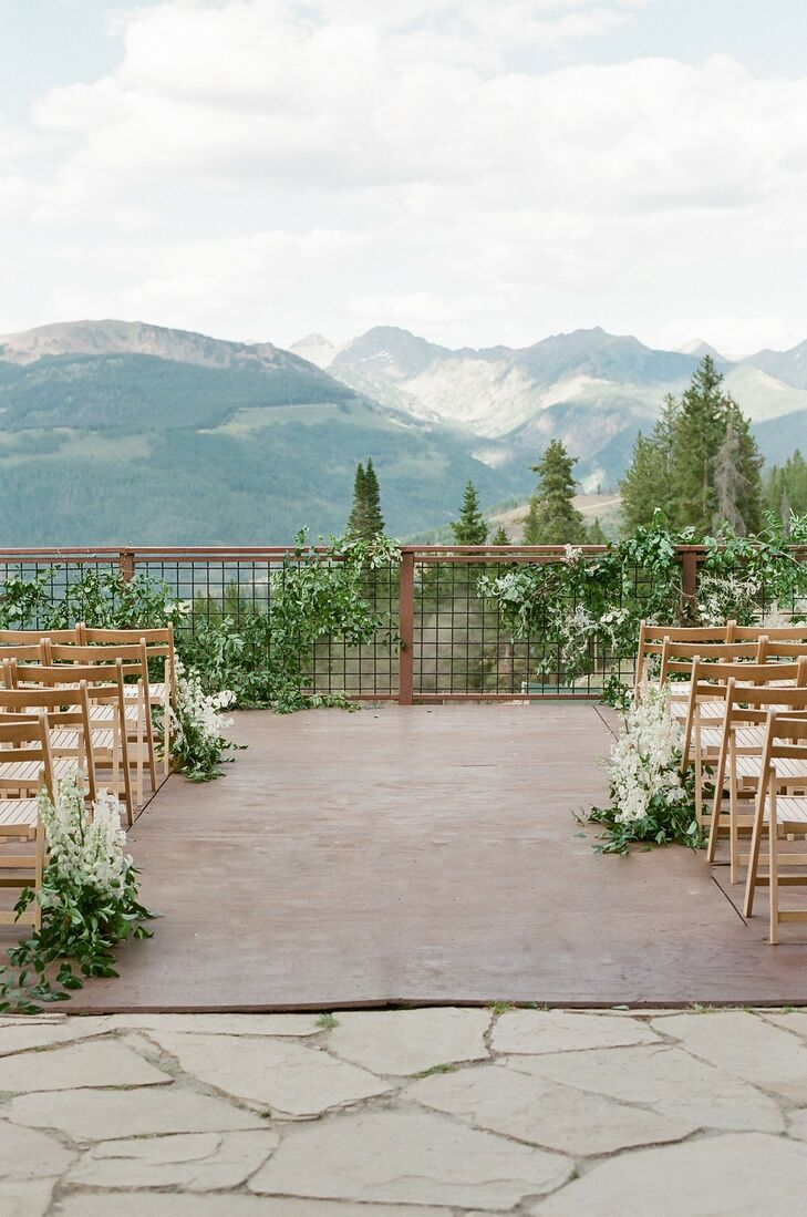 Ceremony Site with Mountain Views and Folding Chairs at The 10th in Vail, Colorado