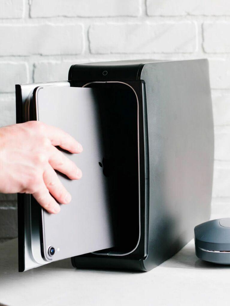 person using HomeSoap UV sanitization box