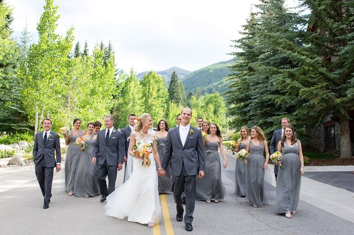 The groomsmen wore gray Vera Wang tuxedos with black ties and black suspenders.