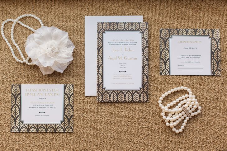 Nothing says art deco like a gold and black fan-inspired invitation suite. Jaris and Angel set the tone for their Gatsby-worthy fete with metallic stationery. Corresponding gold and black font marked each card on a white backdrop. A matching geometric border added to the theme and surrounded their text.