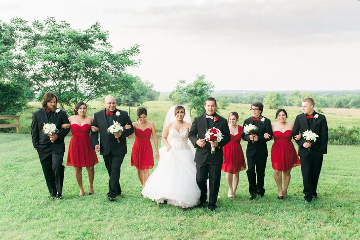 "As for her bridesmaids, ""I had to have red bridesmaids dresses,"" she says. The guys looked sharp in their fitted black tuxedos with red bow ties."