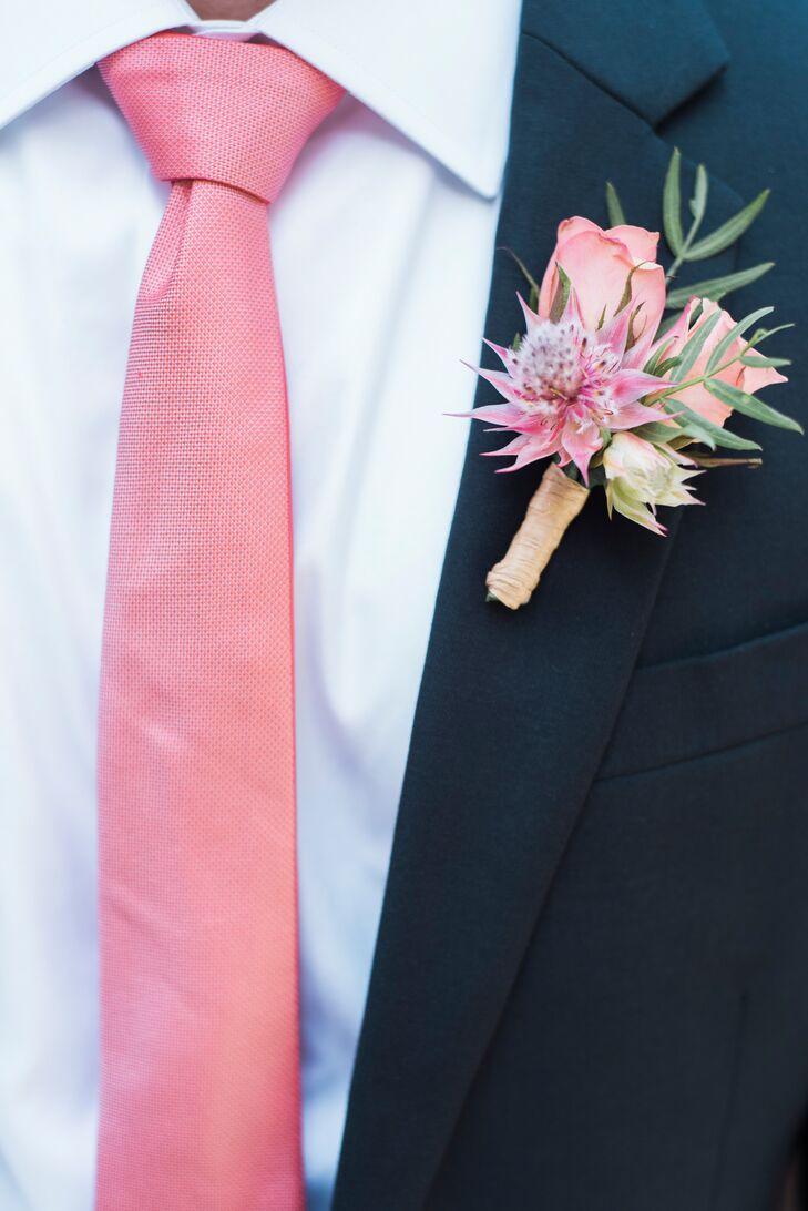 Adam wore a dark navy suit with a soft pink tie that coordinated with his colorful rose blossom boutonniere.