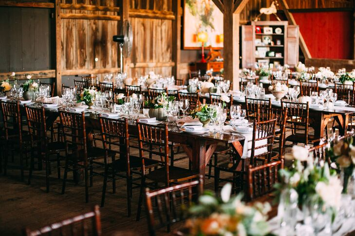 The reception was held in a barn at Riverside on the Potomac in Leesburg, Virginia. A family style meal catered by Culinary Delights by Feist was served on farmhouse style tables set with brown chiavari chairs.