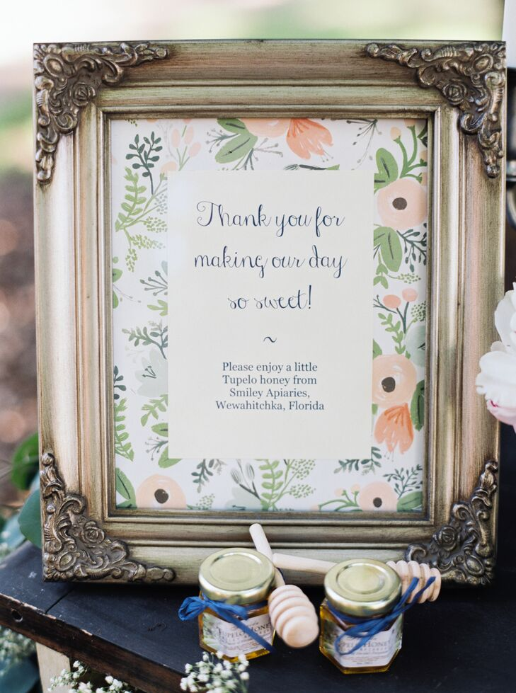 Their DIY signs went full circle at the reception. Made by Laurie's sisters, the seating chart along the entrance and the wedding favor sign for the end of their party had a floral background with ranunculus-inspired illustrations and greenery.