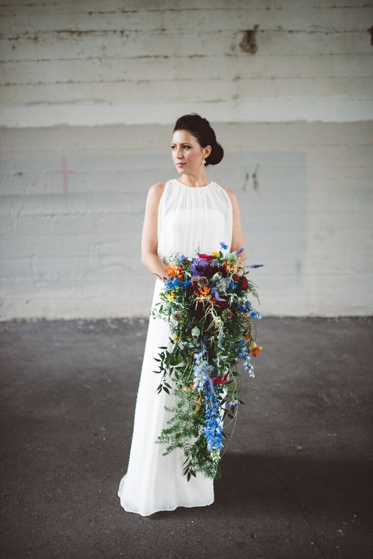 Shorey's bouquet included blue delphiniums, anemones, ranunculus, safflower, poppy pods, freesia, dahlias, drumstick alliums, thistle and greens.