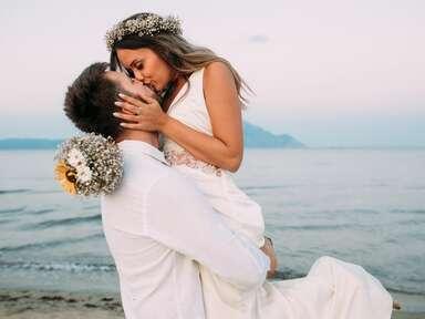 Bride and groom kissing at destination wedding