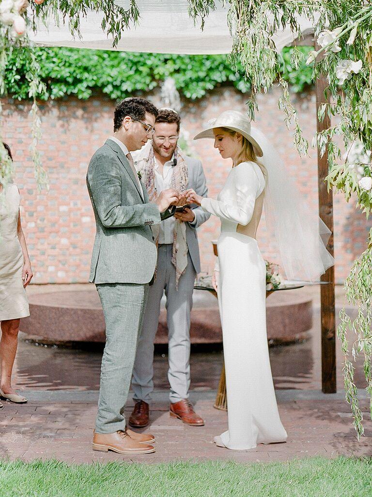 Unique bridal fashion idea with a chic sun hat