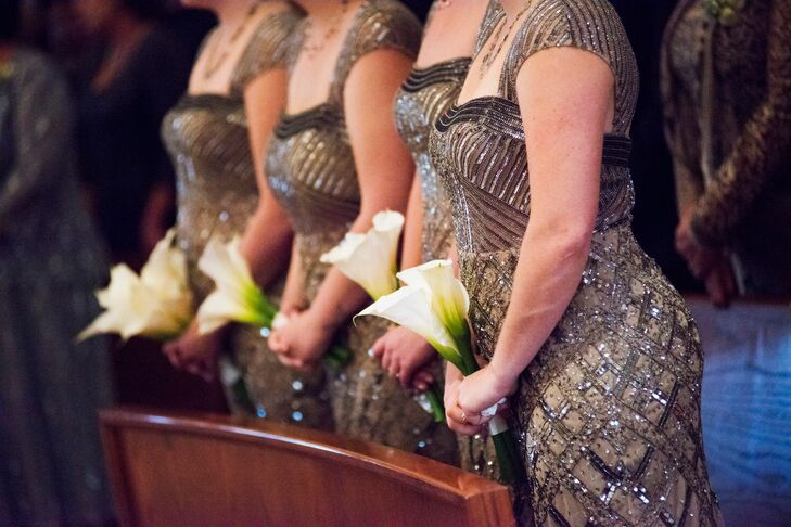 The bridesmaids wore ornately beaded gray and nude dresses from Nordstrom Wedding Shop. Jessica loved how the chichi gowns added a little glamour to the wedding party's attire. The bridesmaids completed their look with simple calla lily bouquets, which added a pop of fresh green.
