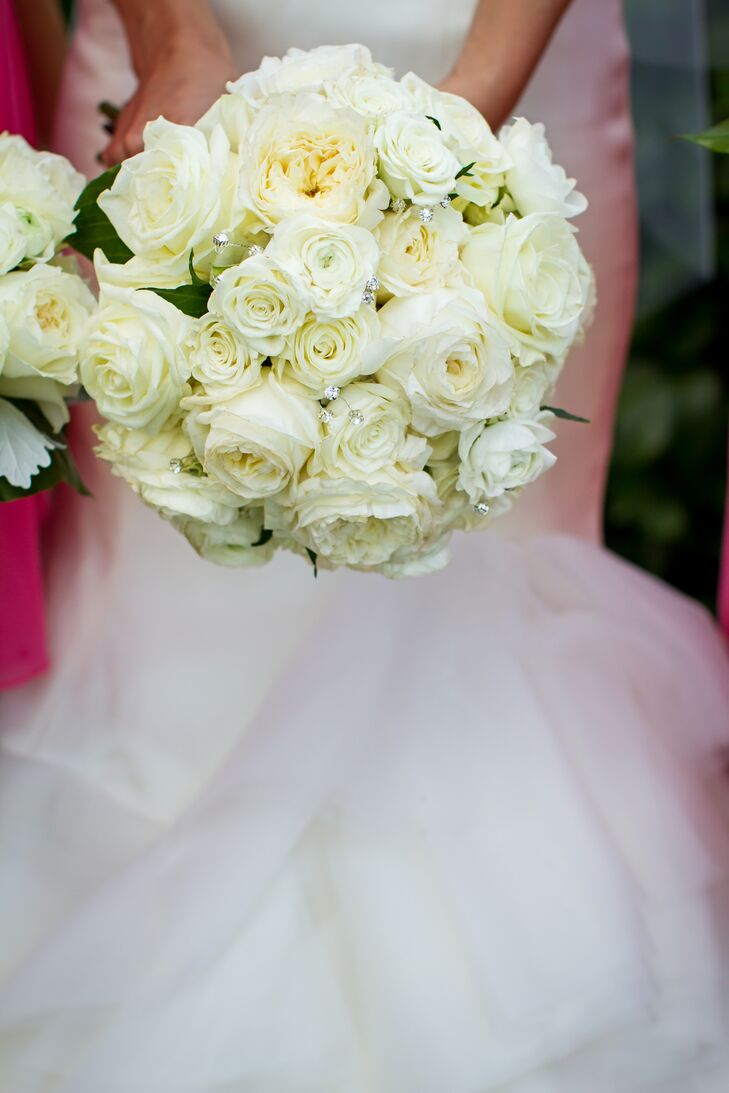 Melissa carried roses, garden roses and ranunculus accented with crystals in her bouquet.