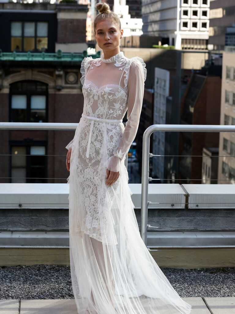 Eisen-Stein Spring 2020 Bridal Collection sheer wedding dress with floral embroidery and ruffle sleeve details