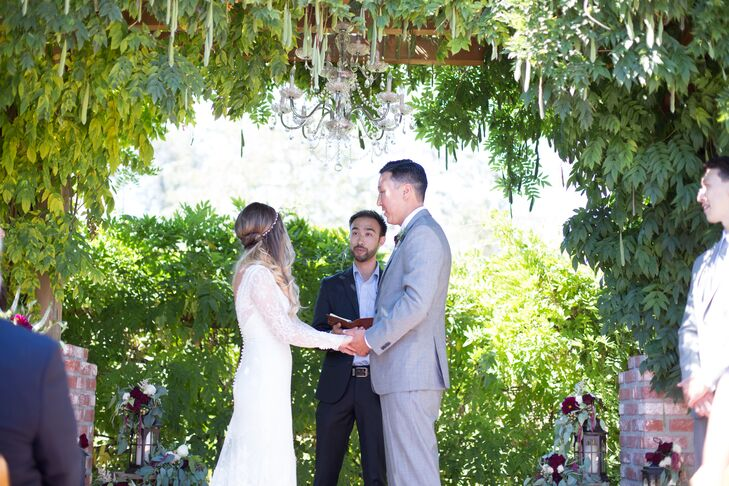"Jenna Mae and Doug exchanged vows under a floral arch in the venue's garden. ""The venue was perfect for us because it was a one-stop place for everything, and it was gorgeous,"" Jenna Mae says. ""We didn't have to decorate much since most of the plants were in bloom or full of green."""