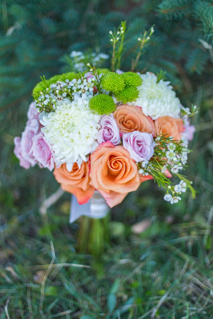 Abby carried orange and lavender roses, green chrysthanthemums and white dahlias