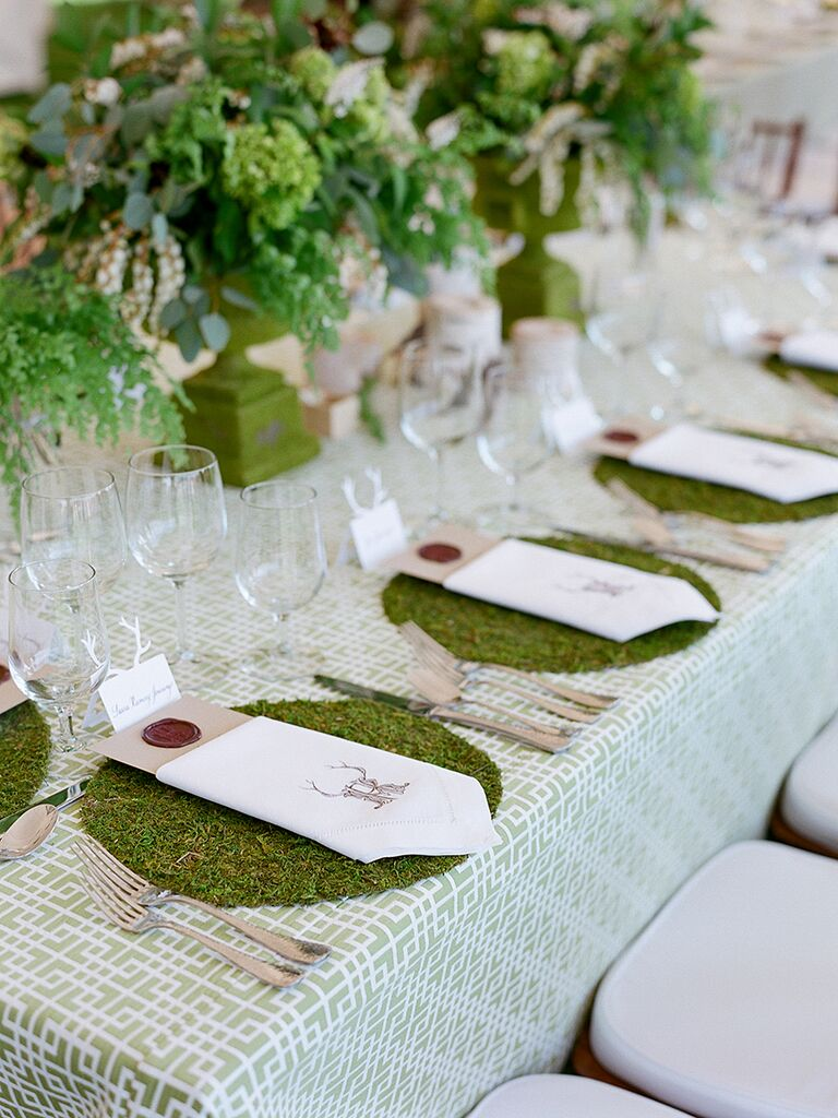 Rustic wedding centerpiece idea with moss place settings and lush arrangements