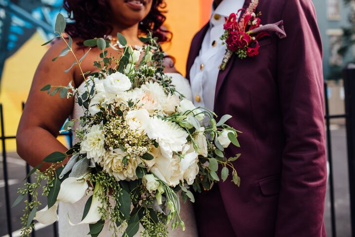 Brittani's bouquet featured an ivory floral arrangement, ample greenery  and a long floral train to complement her gown.