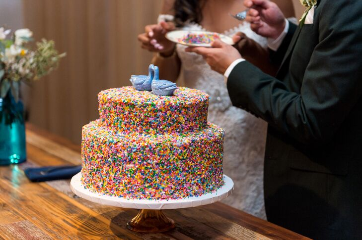 Marla and Trevin had two small cakes: a simple ivory buttercream cake and another covered in colorful sprinkles.