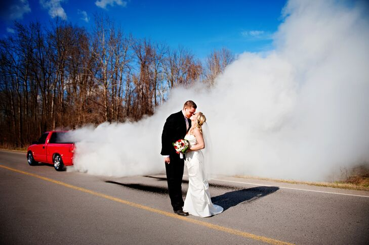 Jennifer Newberry Photography took burnout photos of Cory's red pickup truck, adding a unique touch to the couple's wedding photos.