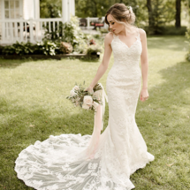 bride in Shelby wedding dress holding bouquet
